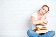 Tired student girl asleep hugging books Royalty Free Stock Photos