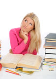 tired student girl with lots of books thinking Royalty Free Stock Photography