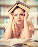 Tired student girl reading books Royalty Free Stock Images