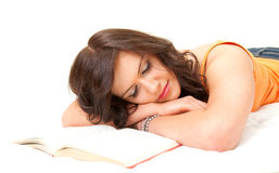 Tired student girl sleeping near the book Stock Photos
