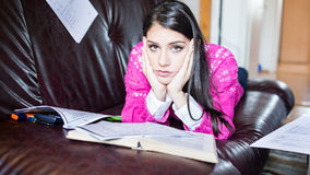 Tired student having a lot to read.Worried stressed student.Student is studying. Study up Stock Photography