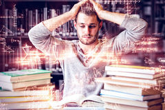 Tired student having too much to do. In library Stock Images