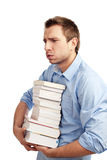Tired student holding books. Tired student standing with books. Isolated on white Stock Photo