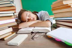 Tired student lies and sleep on the books. royalty free stock photography