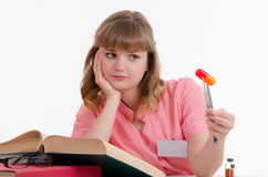 Tired student with a pill Stock Photos
