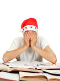 Tired Student in Santa Hat Royalty Free Stock Image