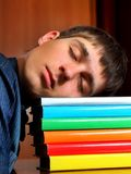Tired Student sleeping. Tired Student sleep on the Books at the Home Royalty Free Stock Images