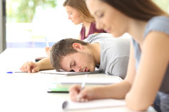 Tired student sleeping in a class at classroom Stock Photo
