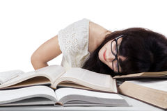 Tired student sleeping on desk Stock Photo