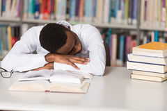 Tired Student Sleeping In Library Stock Photography