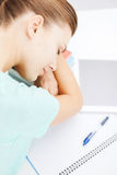 Tired student sleeping on stock of books Royalty Free Stock Photos