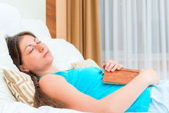 Tired student sleeps with a book Royalty Free Stock Image