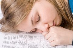 The tired student sleeps on books Royalty Free Stock Image
