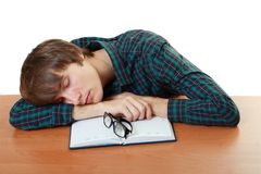 Tired student slieeping Stock Photos