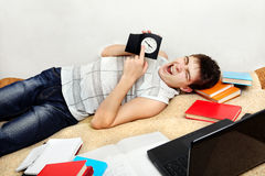 Tired Student on Sofa Royalty Free Stock Photography