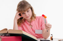 Tired student studying composition pills Royalty Free Stock Photo