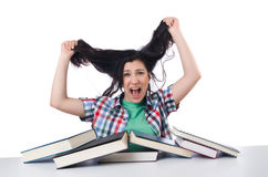 Tired student with textbooks Stock Photo