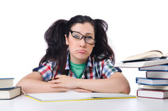 Tired student with textbooks. On white Stock Photography