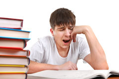 Tired Student is Yawning. Tired Student Yawning on the School Desk Isolated on the White Royalty Free Stock Image