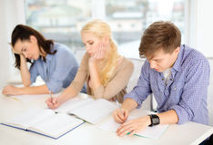 Tired students with notebooks at school Royalty Free Stock Photos