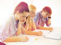 Tired students with notebooks at school Stock Image