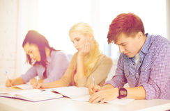 Tired students with notebooks at school royalty free stock photography