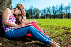 Tired students outdoors Royalty Free Stock Photo