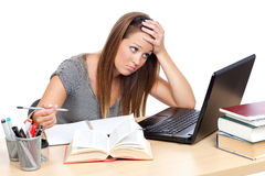 Tired of studying. Girl, at table, having trouble studying Stock Photography