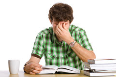 Tired of studying, get me out of here. Student tired of reading his books, isolated on white Royalty Free Stock Photo