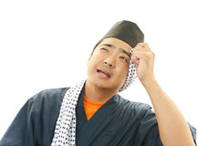 Tired sushi chef Royalty Free Stock Photography