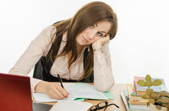 Tired teacher checks students notebooks Royalty Free Stock Image