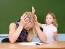 Tired teacher in classroom Royalty Free Stock Images
