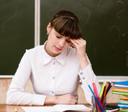Tired teacher in classroom Stock Image