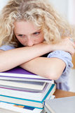 Tired teeenager sleeping on books Stock Photos