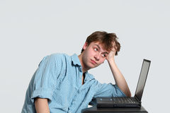 Tired teen boy at computer Stock Photo
