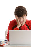 Tired teenage boy using laptop Royalty Free Stock Photo