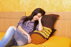 Tired teenage girl falling asleep Stock Image