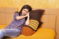 Tired teenage girl falling asleep i. N the bedroom stock photo