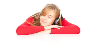 Tired teenage girl with headphones Stock Image