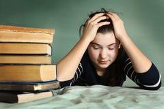 Tired teenage girl sleep among book Stock Photography