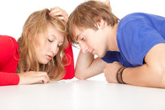 Tired teenage student couple Stock Photos