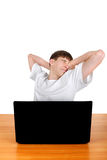 Tired Teenager behind Laptop Stock Images