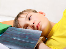 Tired Teenager with the Books Stock Photography