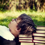 Tired Teenager with a Books Stock Photos
