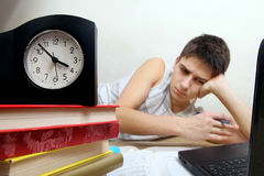 Tired Teenager doing Homework Stock Photography