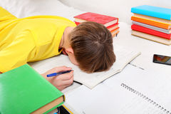 Tired Teenager doing Homework Royalty Free Stock Photos