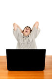 Tired Teenager with Laptop. Tired Student Yawning at the Desk with Laptop Isolated on the White Royalty Free Stock Photo