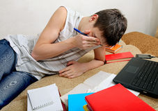 Tired Teenager preparing for Exam Stock Images