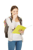 Tired teenager with school backpack. Stock Image