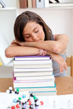 Tired teenager sleeping in a library Royalty Free Stock Images